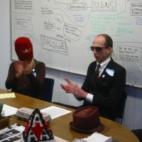 Mabel Negrete (hooded) and Josh Short the Anonymous Business Man