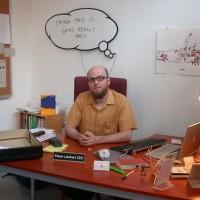 Steve Lambert at his desk