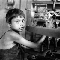 Indian child working on lightbulbs
