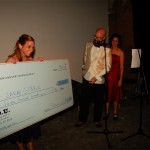 Sarah Gibble receives her giant check
